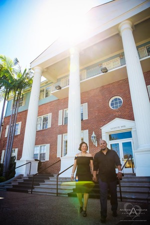 Engaged couple walking at Lafayette Hotel with palms and columns by San Diego Wedding Photographer Andrew Abouna