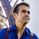 Andrew Abouna headshot with camera harness-